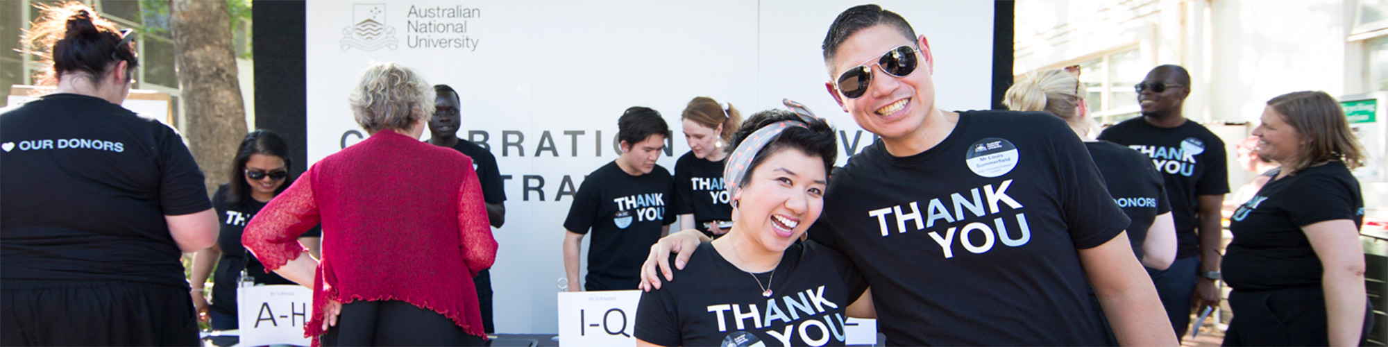 ANU staff at a donor event, wearing Thank You t-shirts