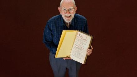 Emeritus Fellow John Dargavel and the 350-year-old book that he has donated to ANU. Photo by Stuart Hay.
