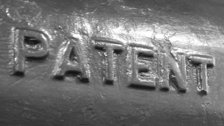 Photo of the word patent embossed in metal