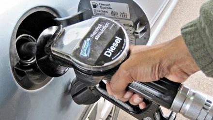 Photo of person filling up car with petrol
