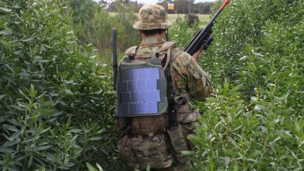Australian soldier wearing solar backpack.