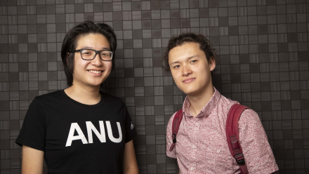 Two ANU students smile to camera