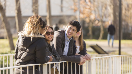 Students huddle in a group