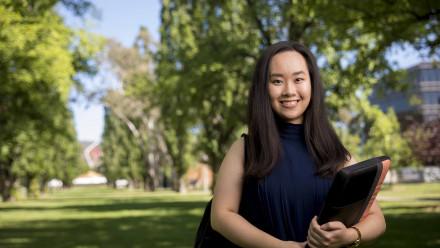 Student smiles to camera
