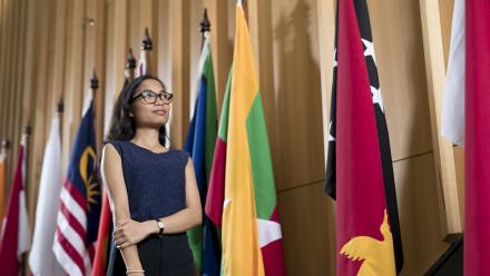 Student at ANU near flags