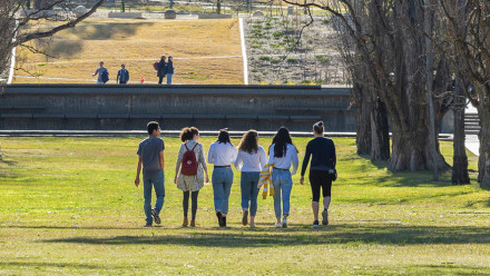 Students walk together on campus