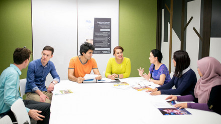 Students sitting around a table talking
