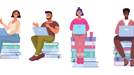 Students on books and using computers
