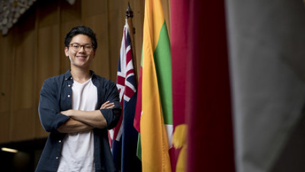ANU student near flags