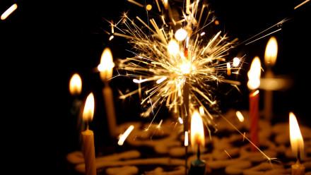 Birthday candles lit on a birthday cake