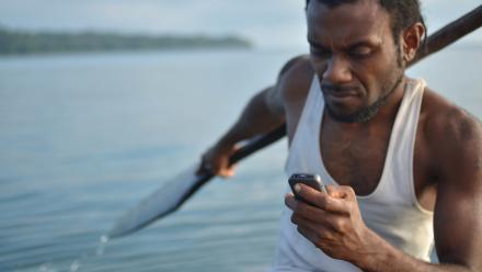 Kelan Sing, a fisherman from Taremb community, on Vanuatu's Malekula Island, says he can now text for help while at sea. Taremb, Malekula, Vanuatu. Photo: Tom Perry / World Bank.