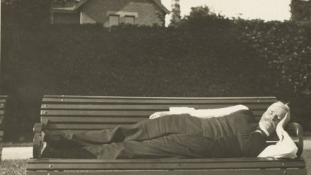 Photo of former Australian Prime Minister, Andrew Fisher, laying down on a bench
