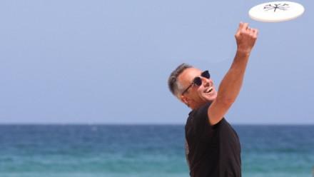 Professor Geoff McFadden throwing a frisbee at Kioloa.