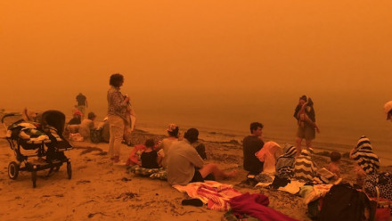 This image was taken by Isobel Davis during the 2019-20 Australian bushfires. The image shows her family on the beach at Batehaven, are having lost her parents' house to the fires.
