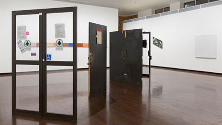 An exhibition at Drill Hall Gallery that showcases disjoint doorways, and walls