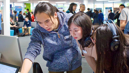 ANU TechLauncher: ideas that shape the future. This photograph has ANU students showcasing their work to attendees