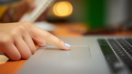Hand hovering over keyboard