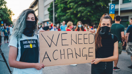 """""""We Need A Change"""" Protest Image"""