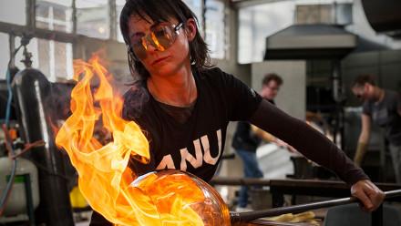A teacher leading a glass workshop at ANU