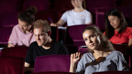 Students watching a lecture at ANU