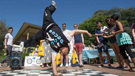 A male student breakdancing at ANU