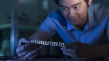 Dr. Mingkai Liu with the prototype meta-device