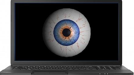 Photo of eyeball on screen of laptop