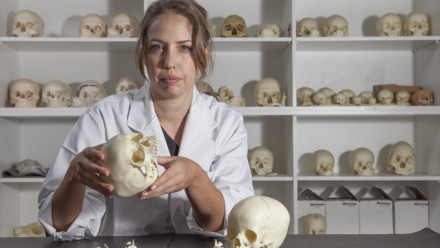 Researcher Clare McFadden examines some skeletal remains. Image: Lannon Harley, ANU.