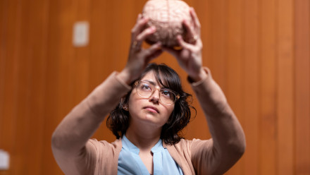 PhD researcher Ms Daniela Espinoza Oyarce inspects a brain model