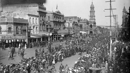 A military band leading South Australian soldiers as they make a farewell march along King William Street, Adelaide. Image: South Australia State Library, flickr.