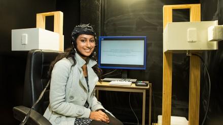 Narrabundah College student Ayisha Ibraham wears an EEG cap that measures brain activity. Image: Stuart Hay.