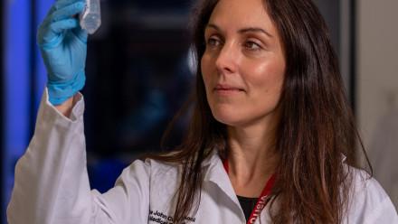Dr Marian Burr holding a test tube