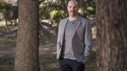 Image of Dr Brett Scholz wearing a grey jacket.