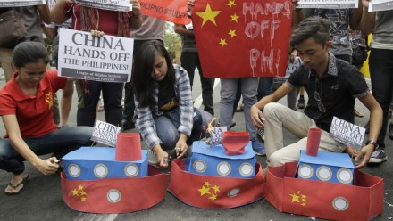 Filipino student activists set fire mock Chinese ships to protest recent island-building. Photo: AP