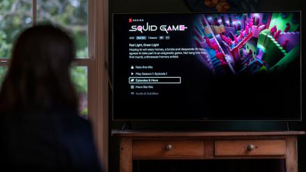Viewer watching popular South Korean survival drama series Squid Game on Netflix