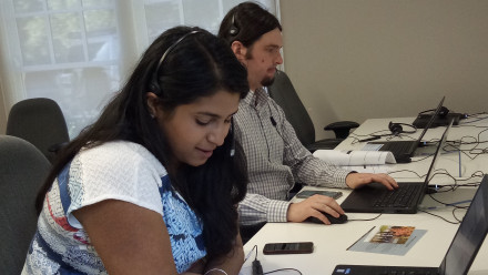 Alumni volunteers call new students to welcome them to the University