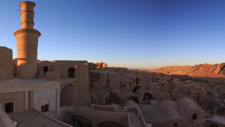 Panoramic view of Kharanaq at sunset near Yazd, Iran. Image courtesy of Valerian Guillor on Flickr.