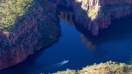 Boat plies the waters of one of the rivers snaking through the Kimberley region of north-west Australia. Image courtesy David Busch on flickr.