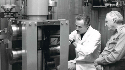 Professor Mervyn Paterson, on the far right, looking at his invention the 'Paterson apparatus', which is still used today. Image courtesy ANU Research School of Earth Sciences.