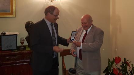 Emeritus Professor Patrick De Deckker receiving his medal at the Belgian Embassy. Photo: supplied.