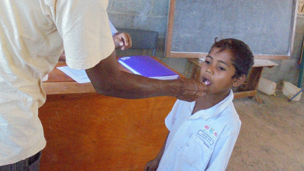 A child receives a deworming tablet at school as part of the (S)WASH-D for Worms research project in Timor-Leste. Credit: Naomi Clarke, ANU