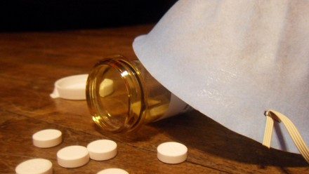 Pills and flu mask. Image by Dylan Cantwell on flickr.