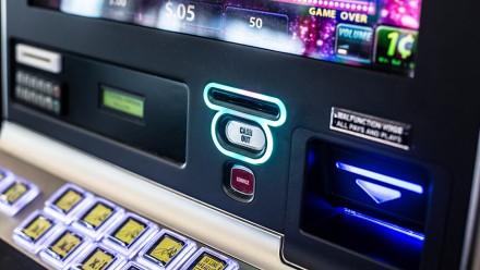 Poker machine. Image by N i c o l a  on flickr.