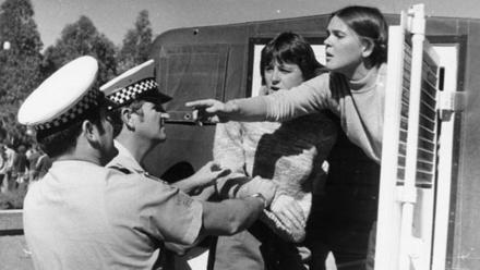 Activists trying to bring attention to the issue of rape in war were arrested for protesting at Anzac Day services in the 1980s. Image: ACT Heritage Library.