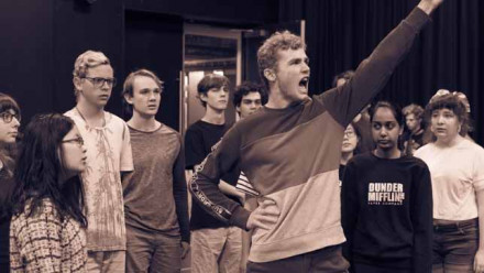 A rehearsal photo of Fenner Hall's 2019 musical The Addams Family. Image: supplied courtesy of the Hall.