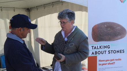 Dr Robyn McKenzie speaks with a local former at a Talking About Stones event. Image: ANU.