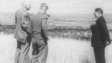 Sir Marcus Oliphant, Sir Keith Hancock and Sir Howard Florey inspect the site of the new Australian National University. Image: ANU Archives.