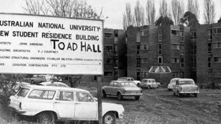 """Taken in the 1970s, this photo shows the words """"Toad Hall"""" plastered on the hall's construction sign out front. The ANU Council subsequently agreed to the name Toad Hall. Photo courtesy Toad Hall."""