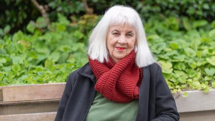 Image of Amanda Lohrey sitting on a park bench.