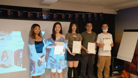 Students holding their certificate for a photo
